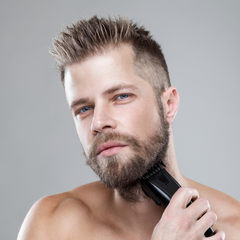 manage your beard men with a shaver