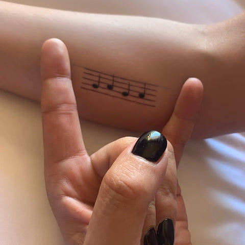 Lady Gaga's clever tattoo of five musical bars and the notes: g-a-g-a