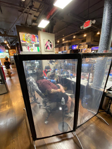 Newly-installed clear wall barriers separate each work area in the NYC Soho tattoo shop for extra precautions during COVID-19. Photo credit: Soho Ink.
