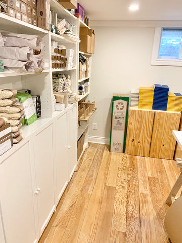 Office space for Kinsfolk Shop shows shelving with products