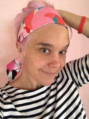 Ashley in our Art Deco Flamingo Headscarf