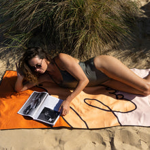 Load image into Gallery viewer, Young woman sunbathing on the beach and reading magazine on Sun Lover travel towel by The Summer Chaser