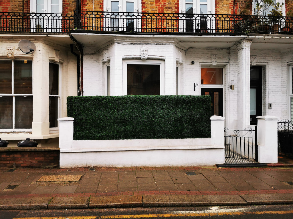 Create an elegant design with artificial hedge for an instant effect.