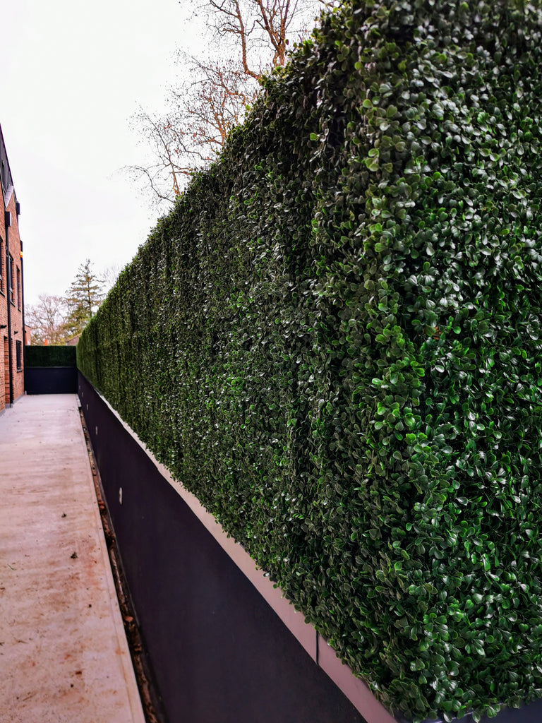 Hide the eyesore with an artificial hedge screen
