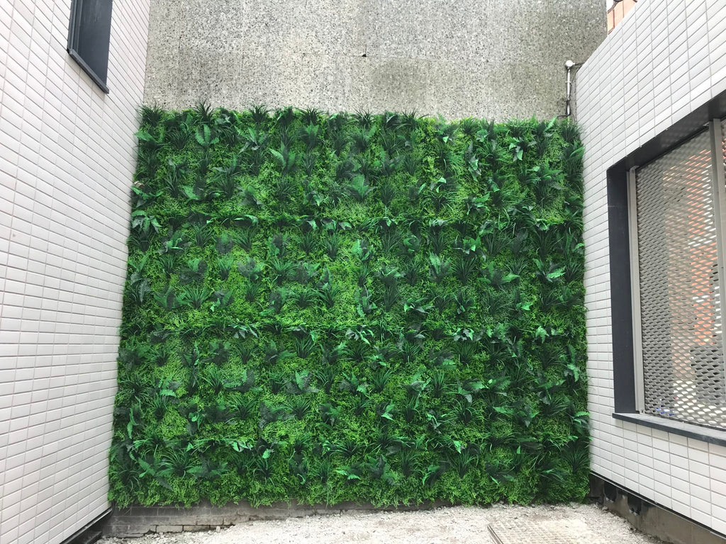 Cover an ugly wall with expanding artificial hedge trellis