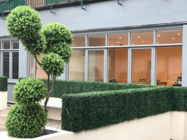 A maintenance free courtyard with artificial hedges