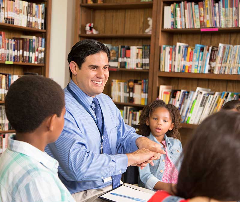 Educator in Library with Children