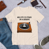 MY LIFE IS STUCK IN A GROOVE. Short-Sleeve Unisex T-Shirt