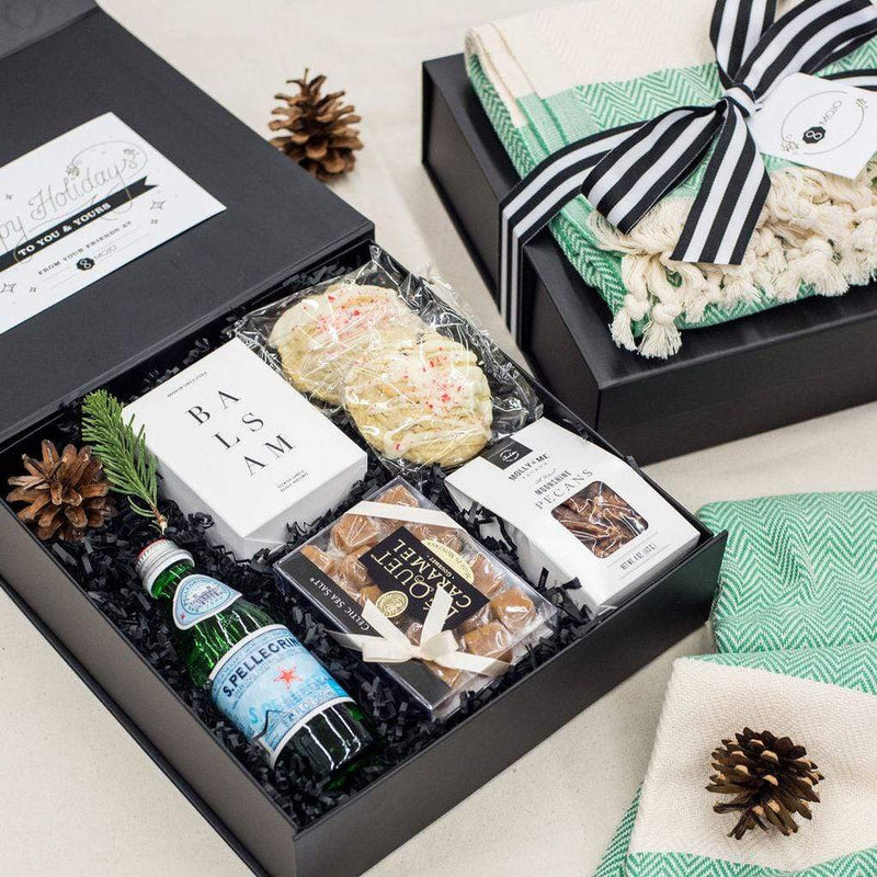 We love taking our corporate clients' brands and bringing them to life in the form of unique, artisan holiday gift boxes. Explore some of our favorite designs at the Marigold & Grey blog.
