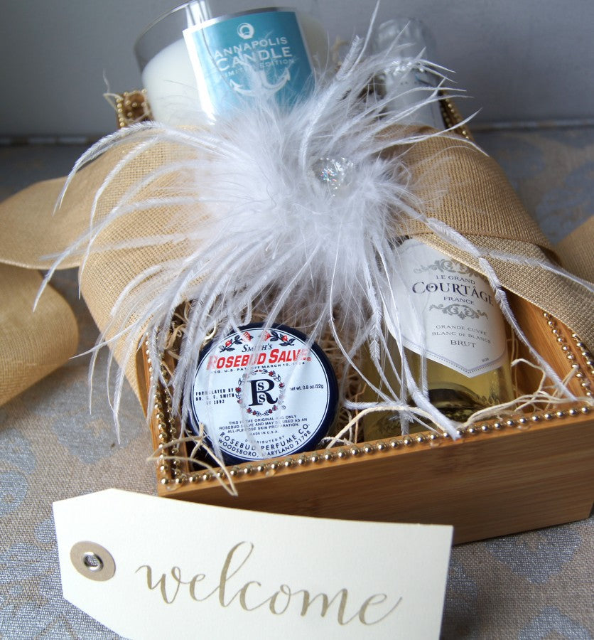 Annapolis-Waterfront-Wedding-Welcome-Gift-Box-Gifttag-Calligraphy-champagne-feathers-ribbon-candle