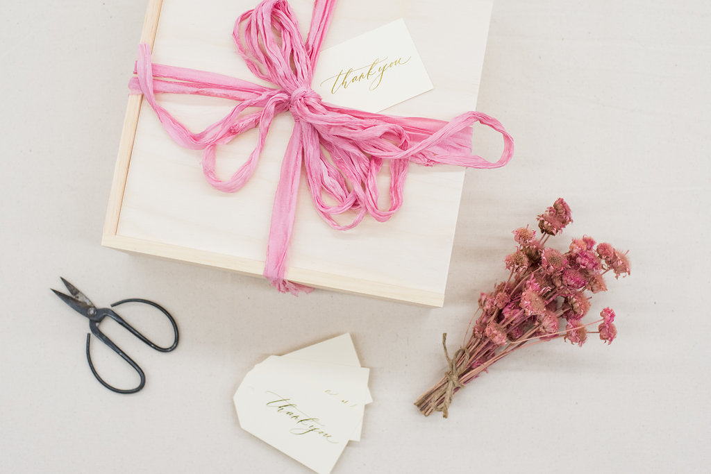 Botanical inspired custom curated gift boxes for luxury wedding floral designer