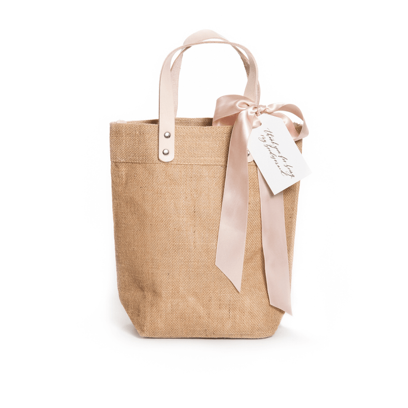 "Shop our signature bridesmaid gift bag, ""Totes Wedding Ready"" from Marigold & Grey."