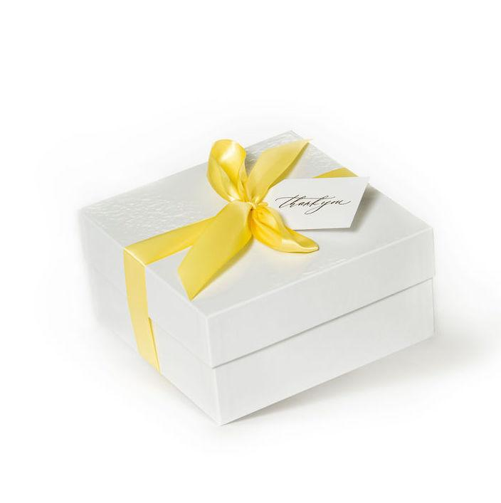 "Shop ""Lovely Lemon"", the signature lemon gift box by Marigold & Grey. Our luxury citrus gifts include free U.S. Shipping and complimentary custom handwritten notecard!"