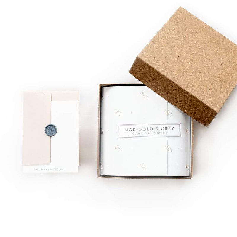 Masculine client holiday gift boxes by Marigold & Grey
