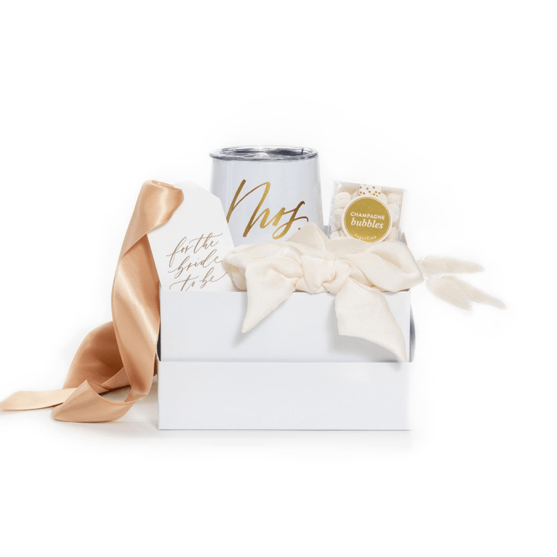 Our 'She Said Yes' gift box features luxury curated items to get the engagement celebration started right!