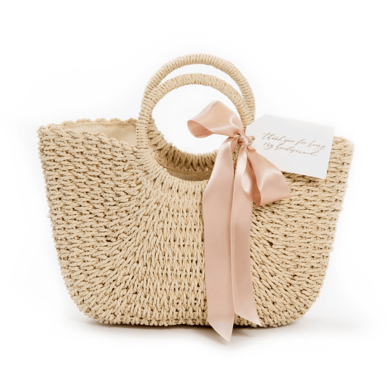 "Shop our signature bridal party gift bag, ""Wedding Weekend"" from Marigold & Grey."