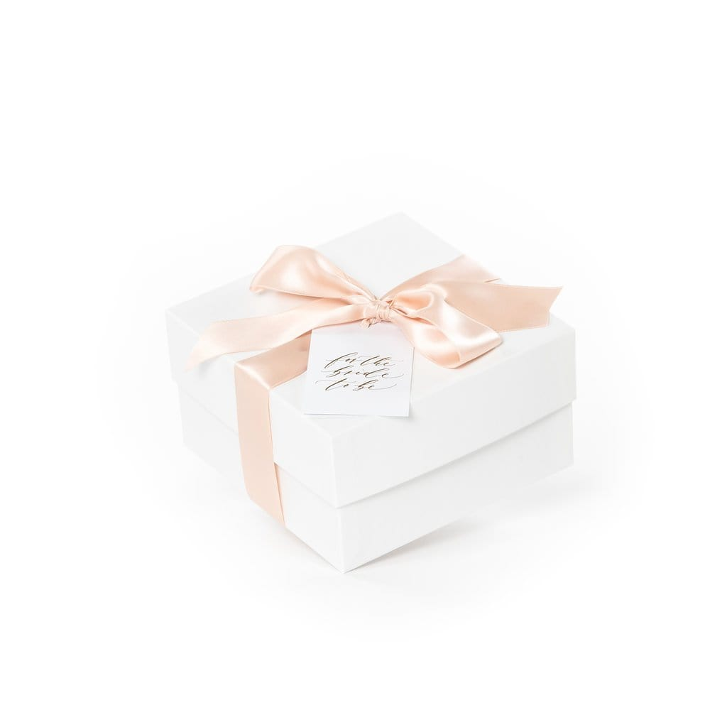 Newly engaged curated gift box for bride-to-be perfect for bridal showers and engagement parties by Marigold & Grey
