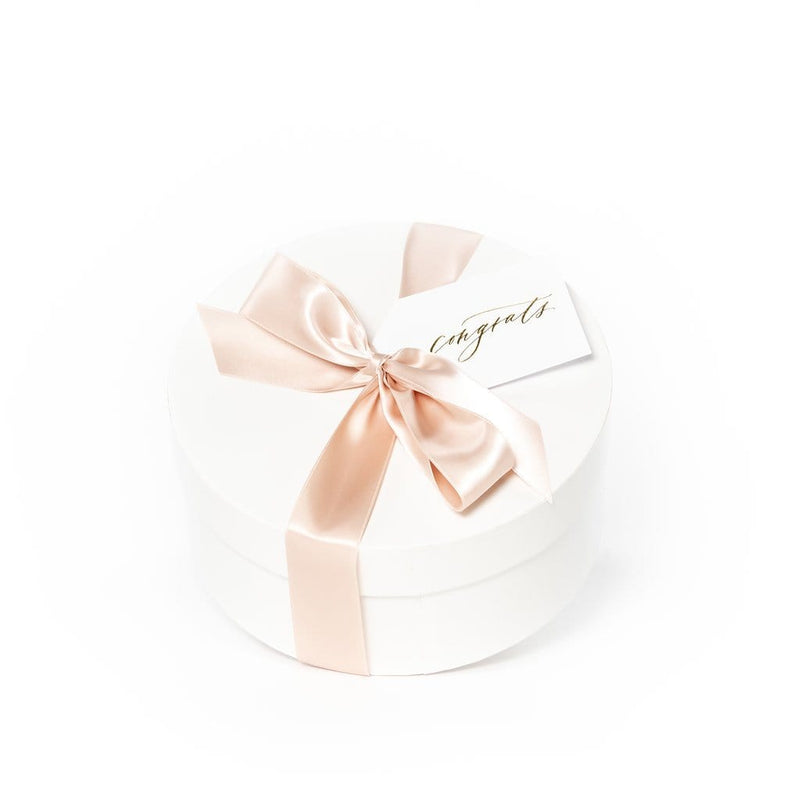 "Shop ""Mom-to-Be"", the signature pregnancy announcement gift box by Marigold & Grey."