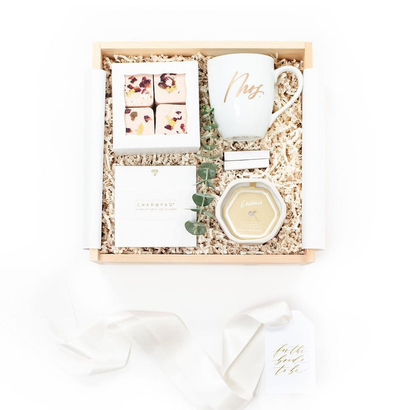 Bride-to-be curated gift box ideas for newly engaged couples