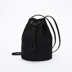 wantmustneed.com / Canvas Bucket Bag | Lisa May Black