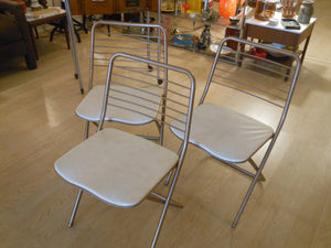 4 Cosco Folding Chairs