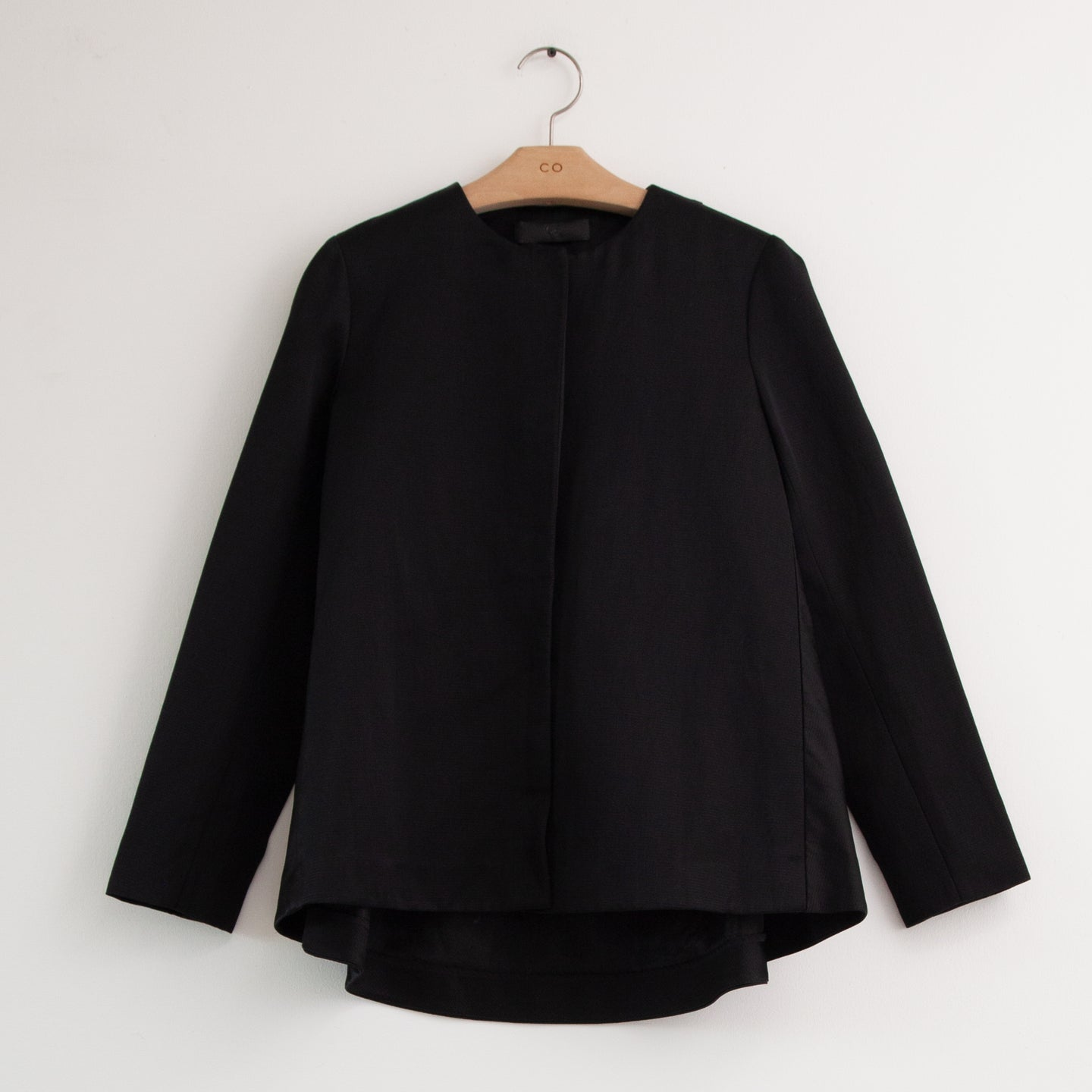 A line long sleeve snap front jacket in black cotton twill - CO