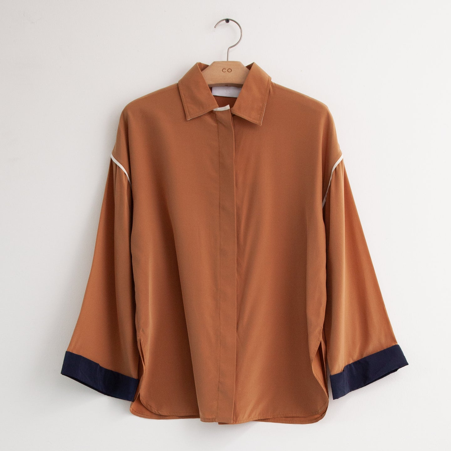 CO - Long sleeve tri color blouse with contrast piping at shoulder and wrists in tan silk
