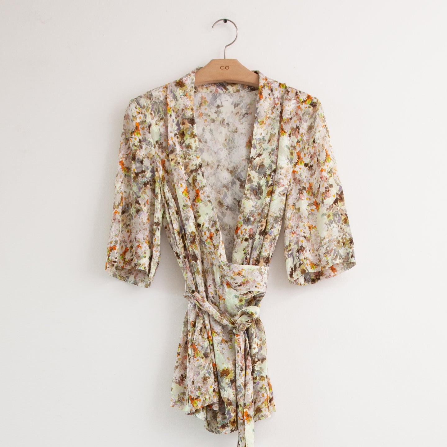 Short sleeve v neck wrap blouse in abstract floral jacquard - CO
