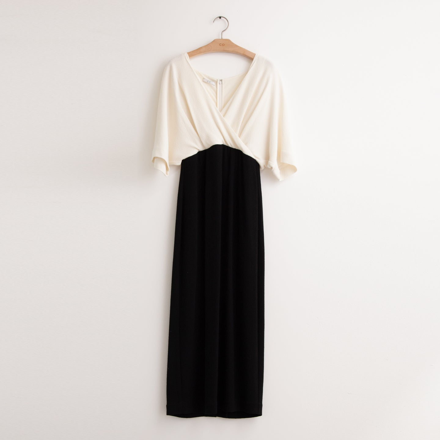 CO - Bi color drape neck dress in black and white pebbled crepe