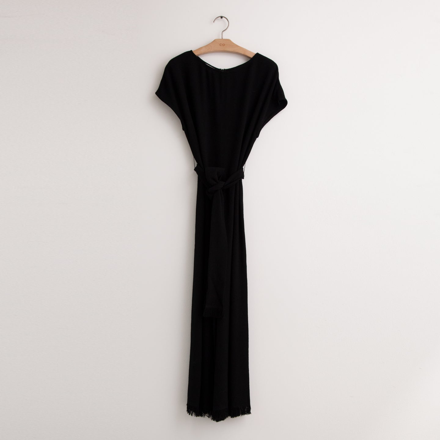 CO - Cap sleeve wide leg jumpsuit with self belt and fringed detail at hem in black pebbled crepe