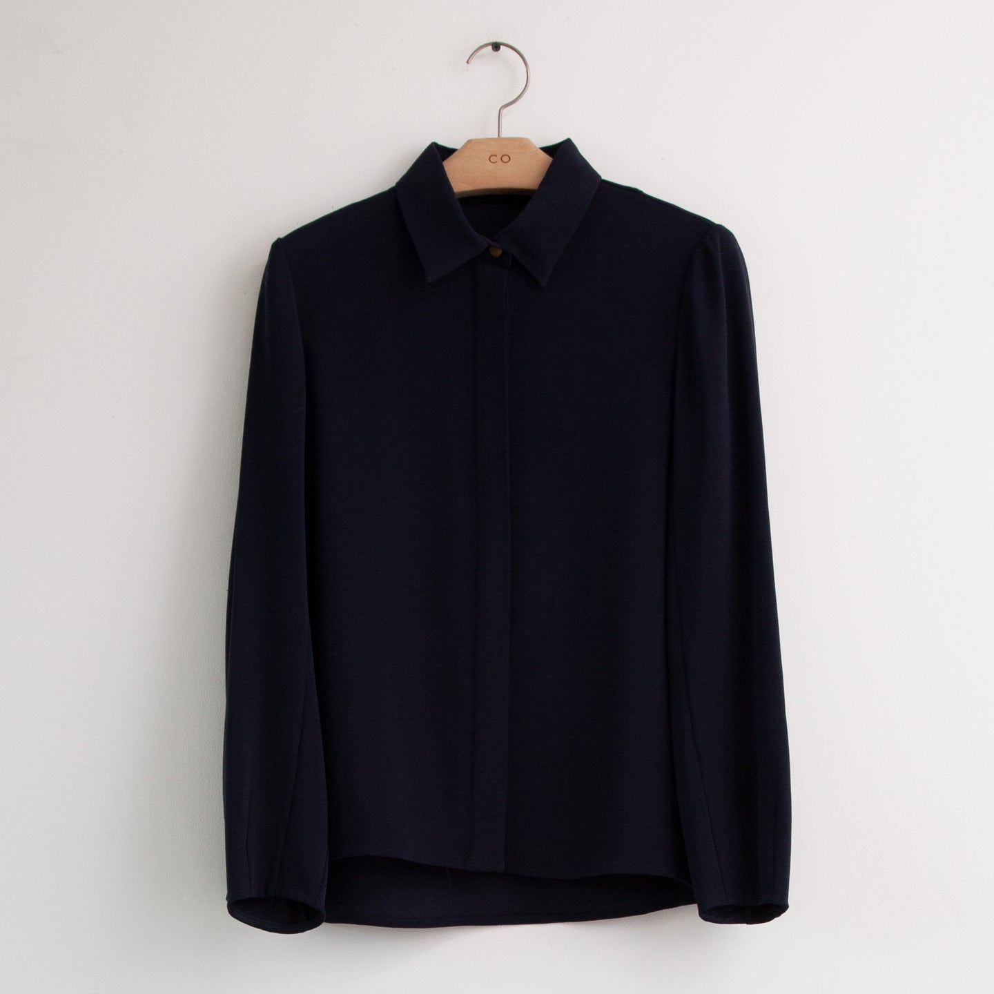 Long sleeve button front covered placket blouse in navy silk - CO