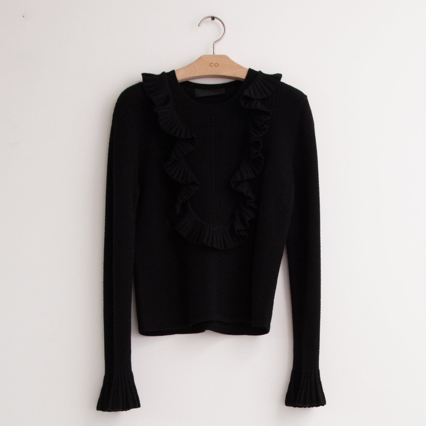 CO - Cable knit sweater with ruffle yolk detail and flared sleeves in black wool