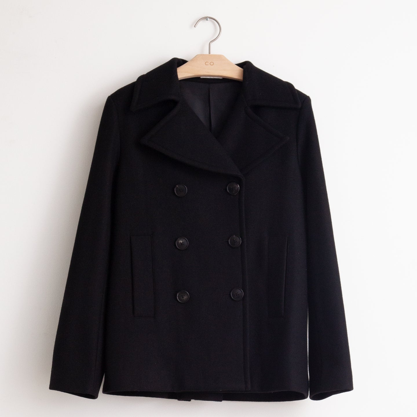 CO - Double breasted pea coat with back pleat in black soft wool