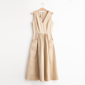 V neck sleeveless gathered waist dress with trapunto hem detail in taupe cotton poplin - CO