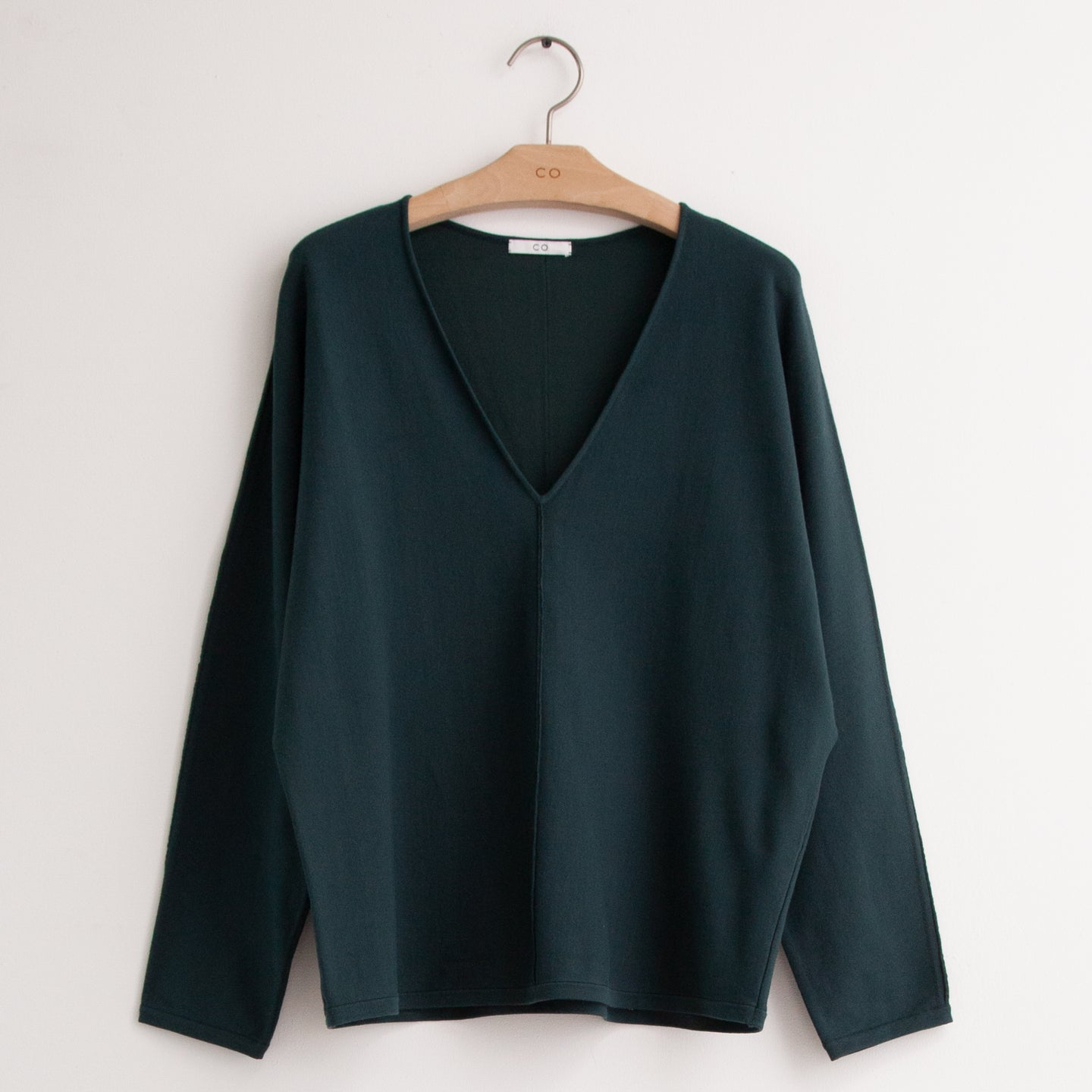 CO - V neck knit with front seam detail in teal compact viscose