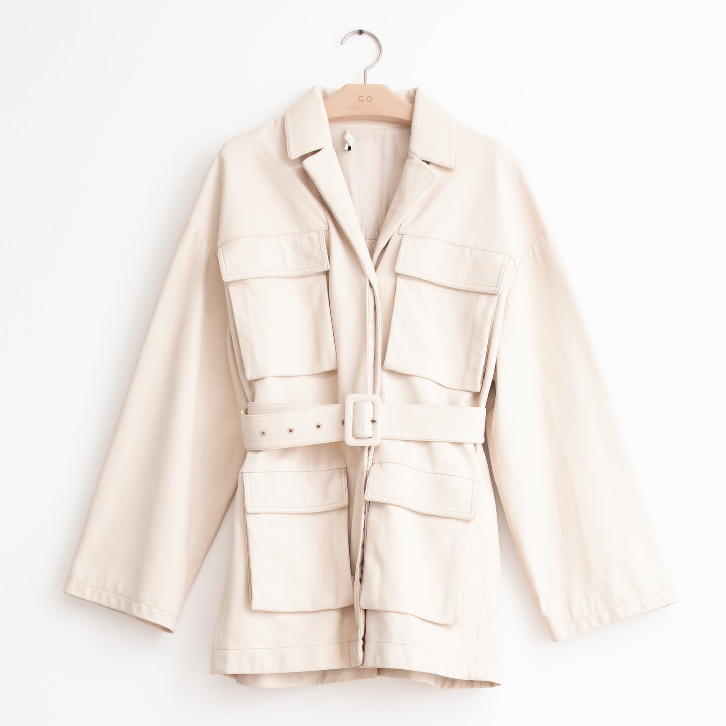 CO - Oversized belted utilitarian jacket with flap pockets in ivory leather