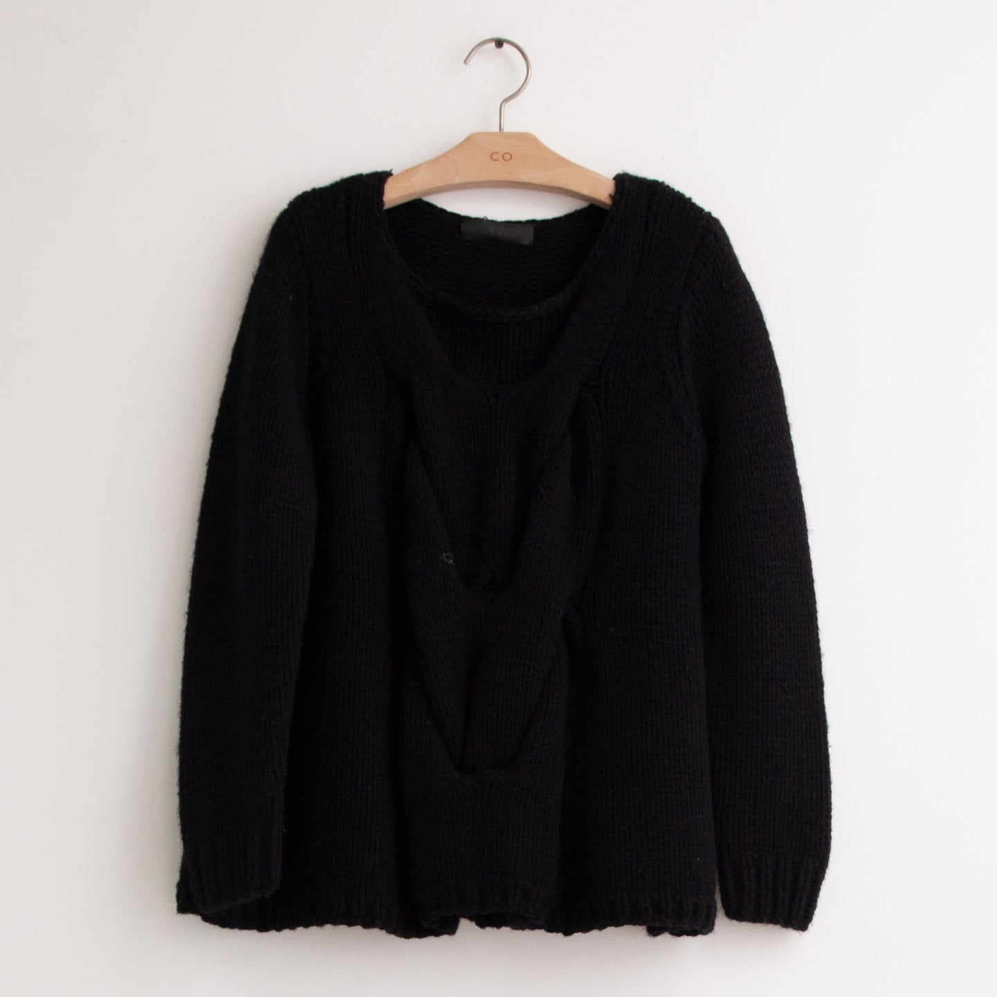 CO - Round neck sweater with exaggerated front cable knit detail in black wool silk