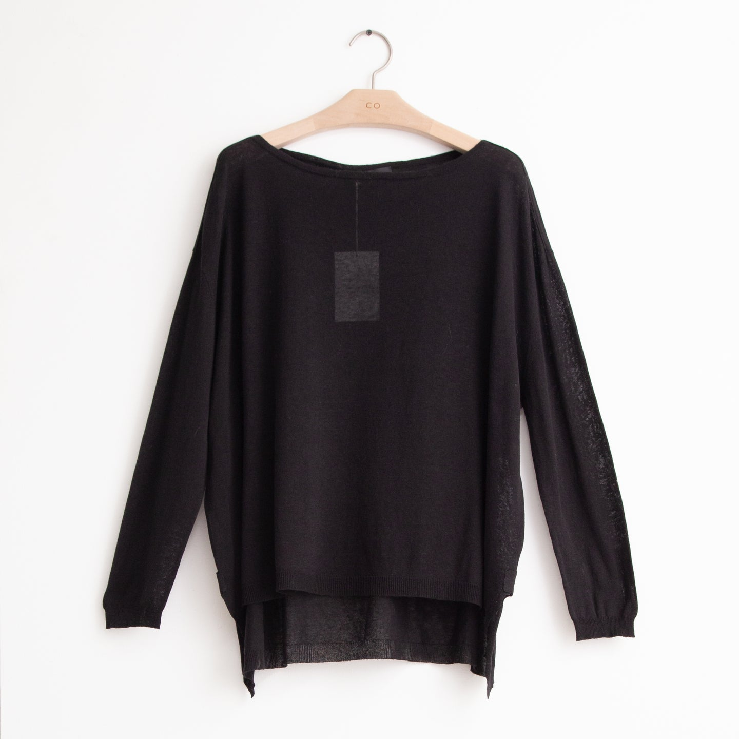 Oversized boat neck sweater with high low hem in black cotton - CO