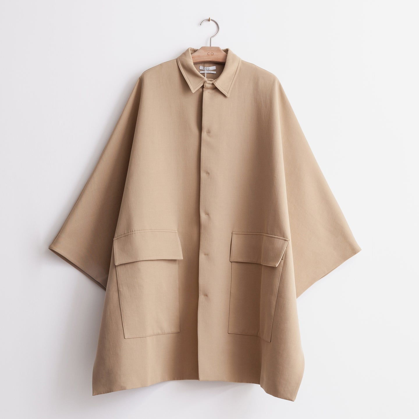 CO - Snap front collared poncho in tan bonded cotton twill