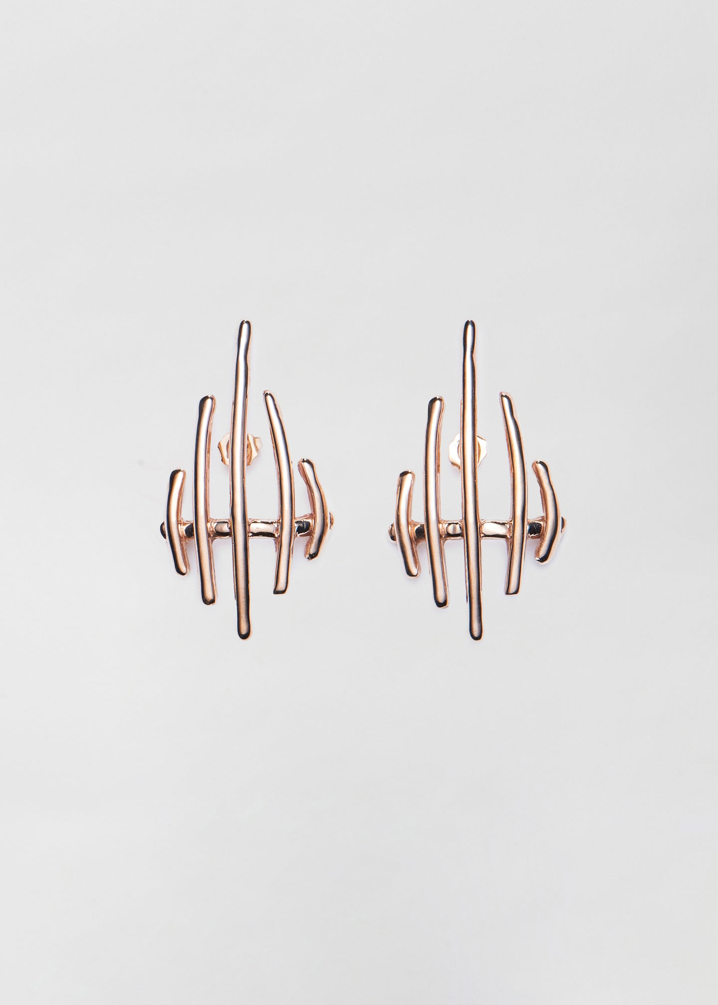 CO - Sculptural Earrings in Bronze