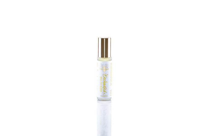 Enchanted pure aromatherapy roll on blend, unique blend of sweet citrus and spice, warming, comforting, all natural perfume