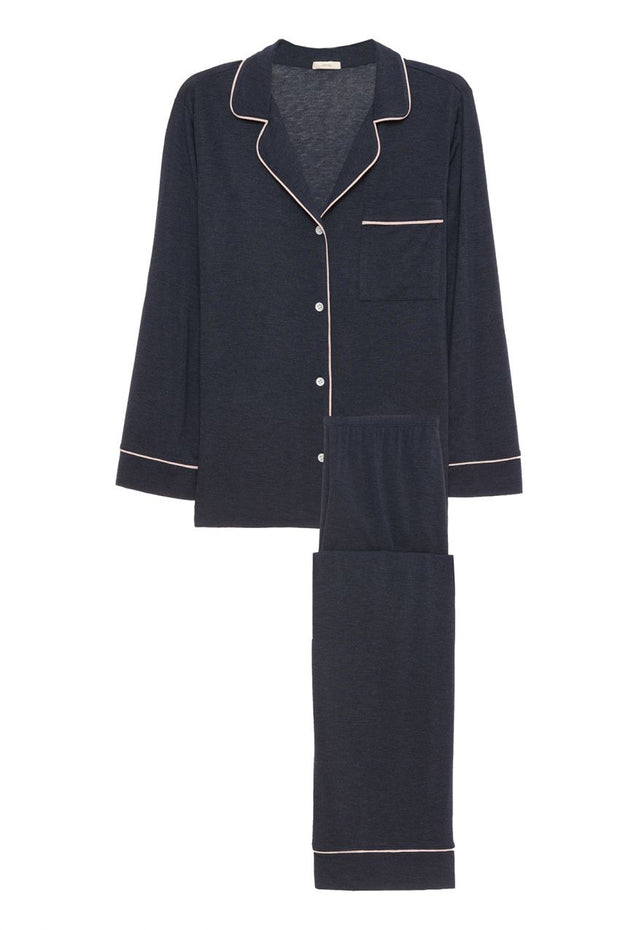 Navy pajama set with ivory piping details and white buttons