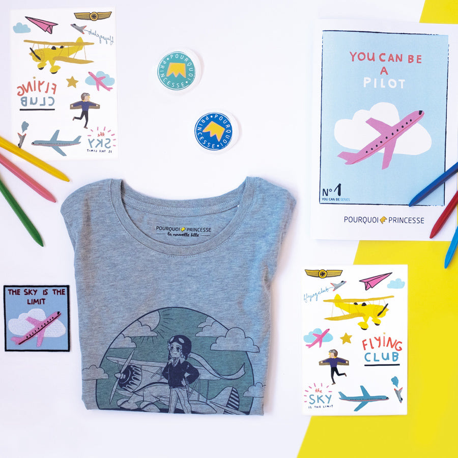 Pourquoi Princesse You Can Be a Pilot Box with organic t-shirt, temporary tattoos, activity book, patch and stickers.