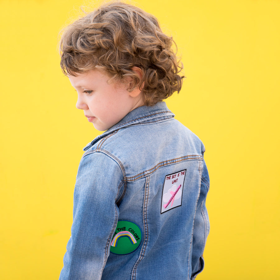 Little girl wearing denim jacket with Pouquoi Princesse iron on