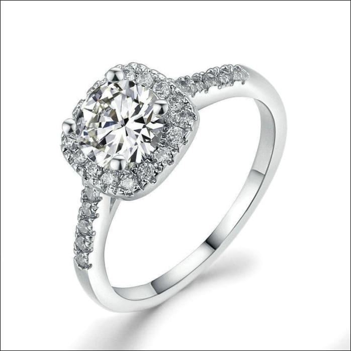 Dainty Engagement Ring With Fine Silver Finished Cubic Zirconia.
