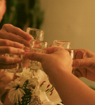 friends toasting with mezcal in shot glasses