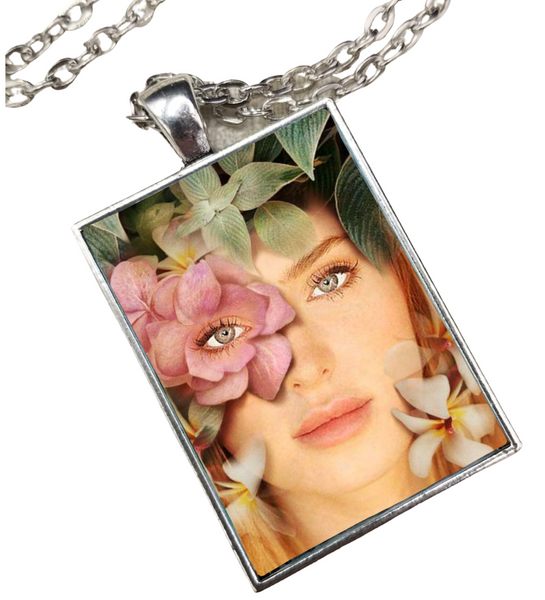 This picture features a custom portrait necklace with a floral design.