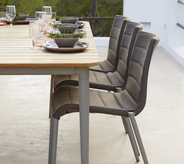 Core Teak and Aluminum Dining Table, 83 x 39 in