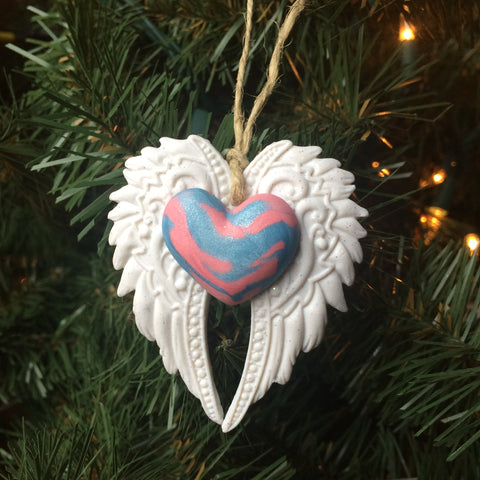 Beautiful angel wings memorial ornament in blue and pink swirled heart to represent pregnancy and infant loss awareness colors.