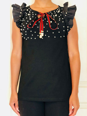 Black sleeveless shirt with ruffle detailing, pearl embellishment and red/black ribbon.